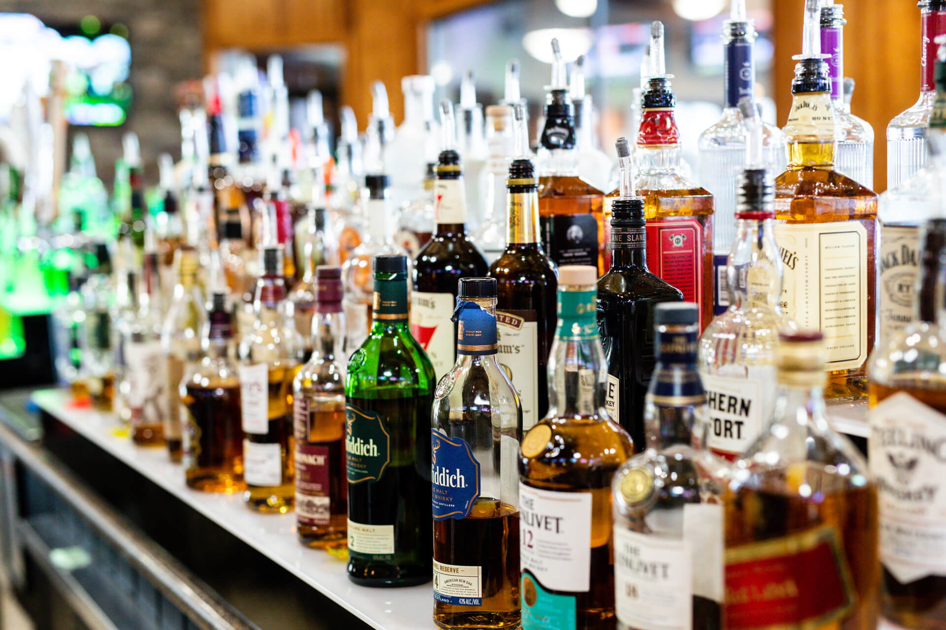 liquor bottles behind bar at camden on the lake