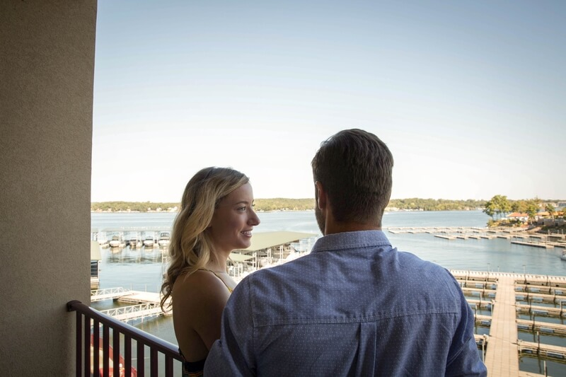 couple on balcony overlooking marina camden on the lake