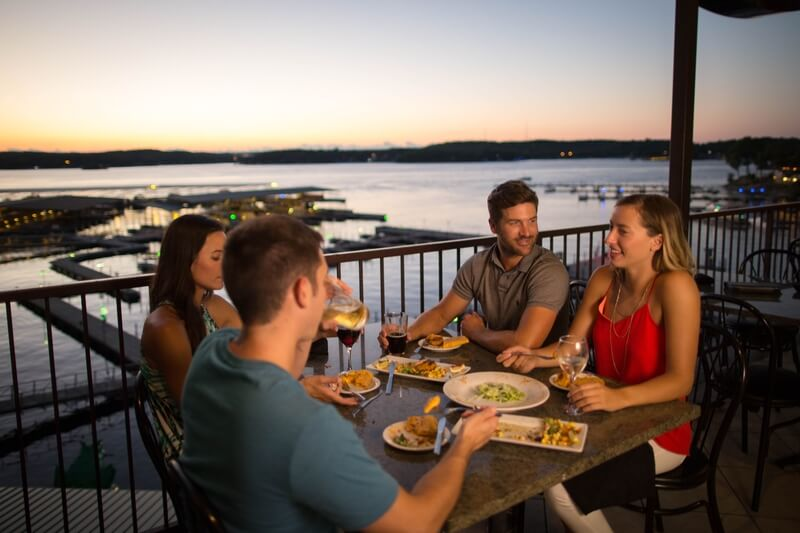 dining at sunset on the deck at camden on the lake view of lake of the ozarks