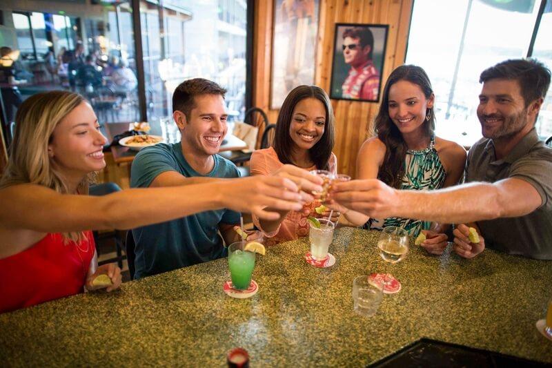 group raising shot glasses at camden on the lake bar