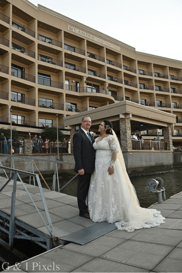 bride and groom on dock at camden on the lake of the ozarks
