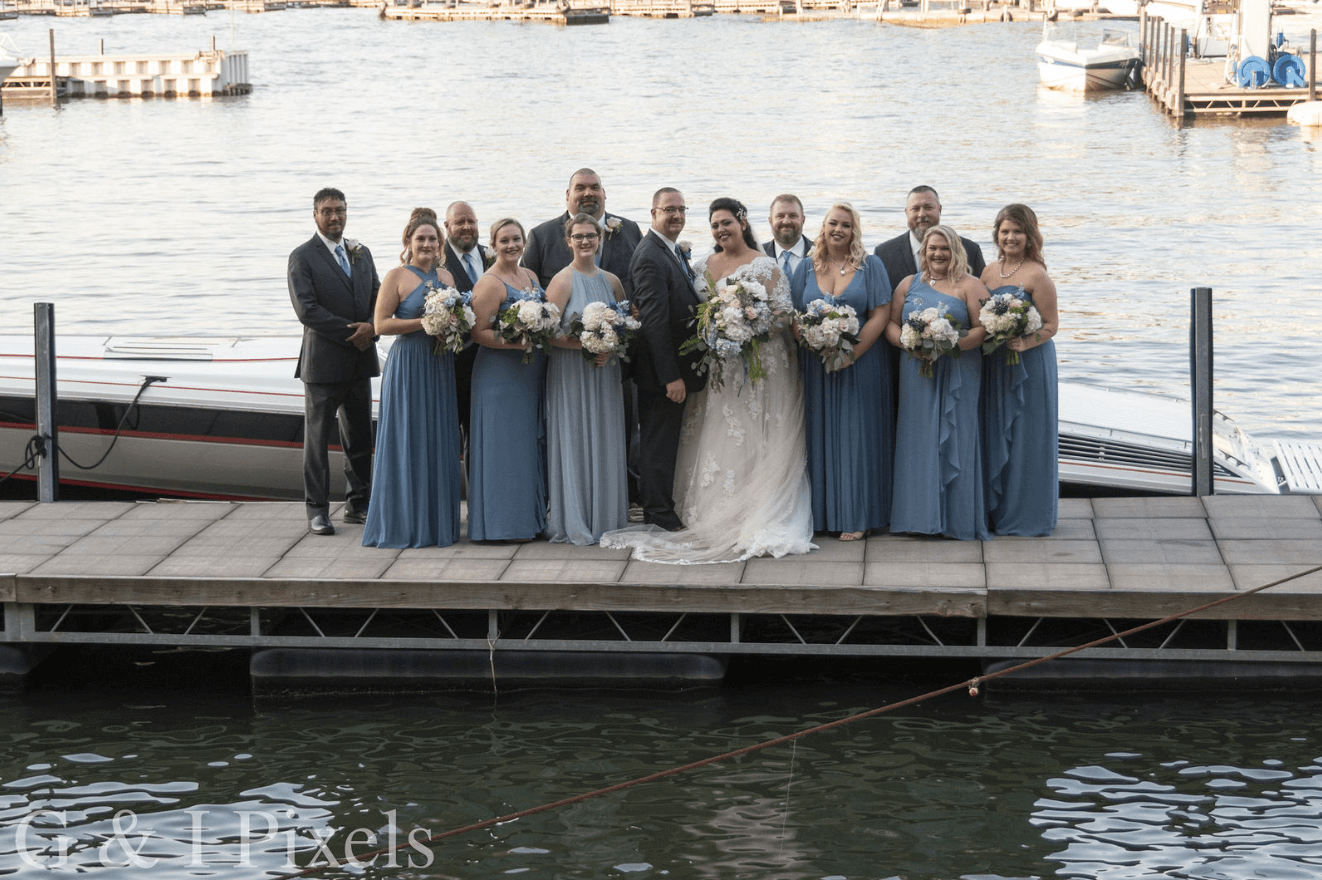 wedding party on dock at camden on the lake