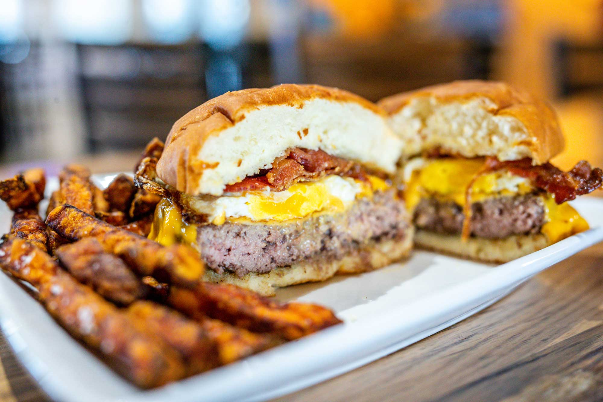 bacon cheeseburger with egg and homemade fries, dining at camden on the lake resort