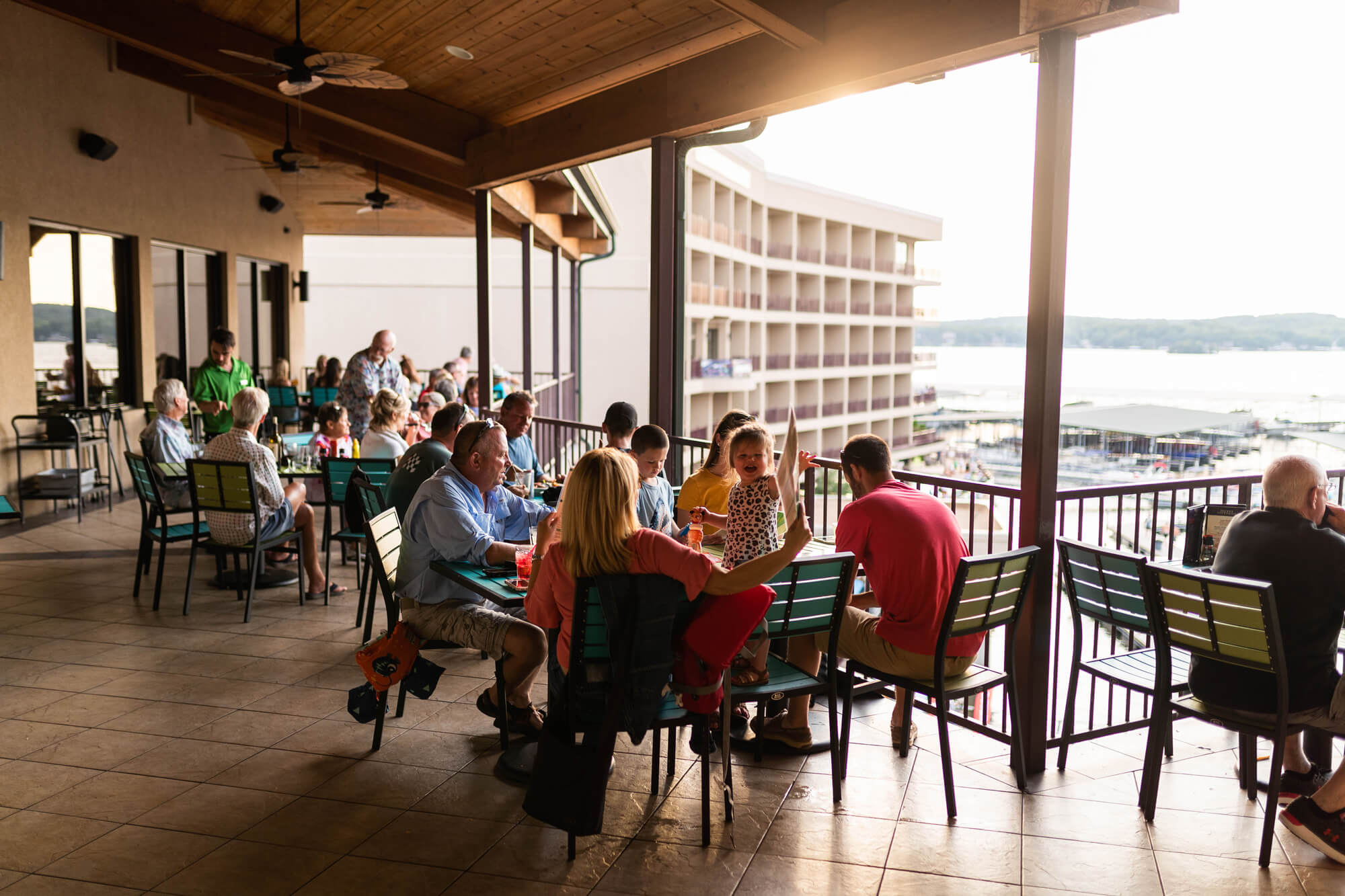 dining on the deck with lake view at camden on the lake