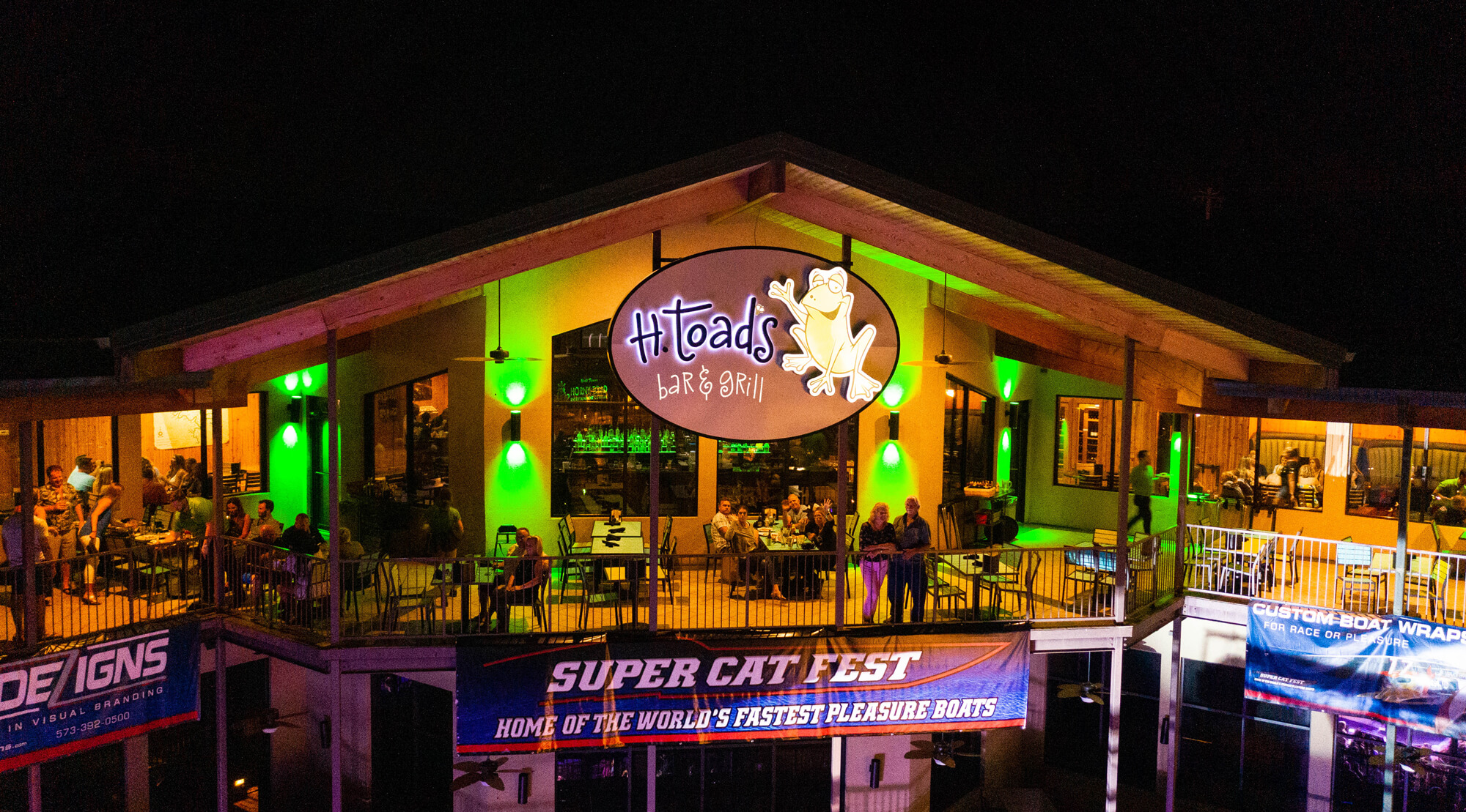h toads bar and grill deck at night ozarks