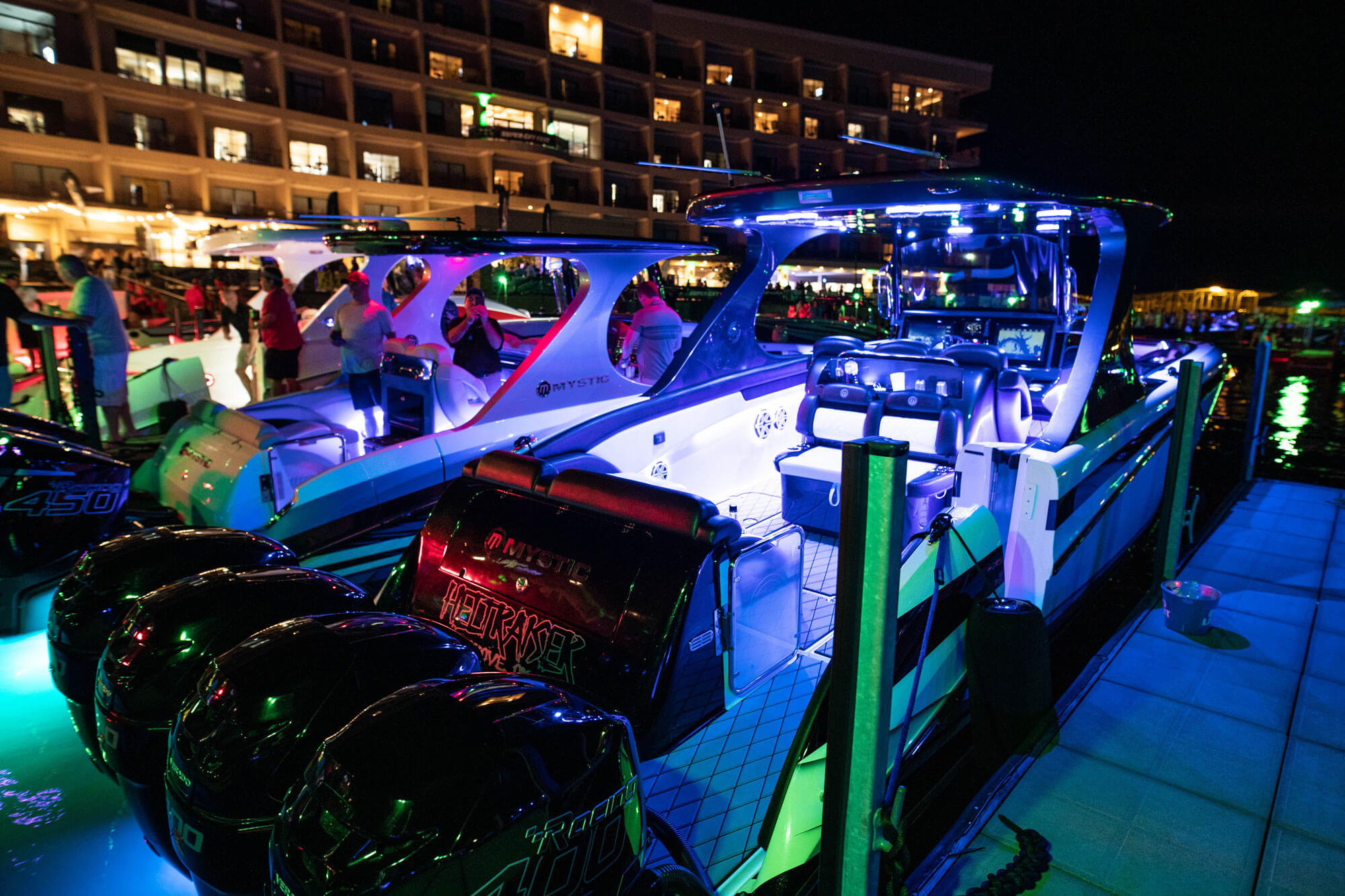 speed boat engines in marina at night