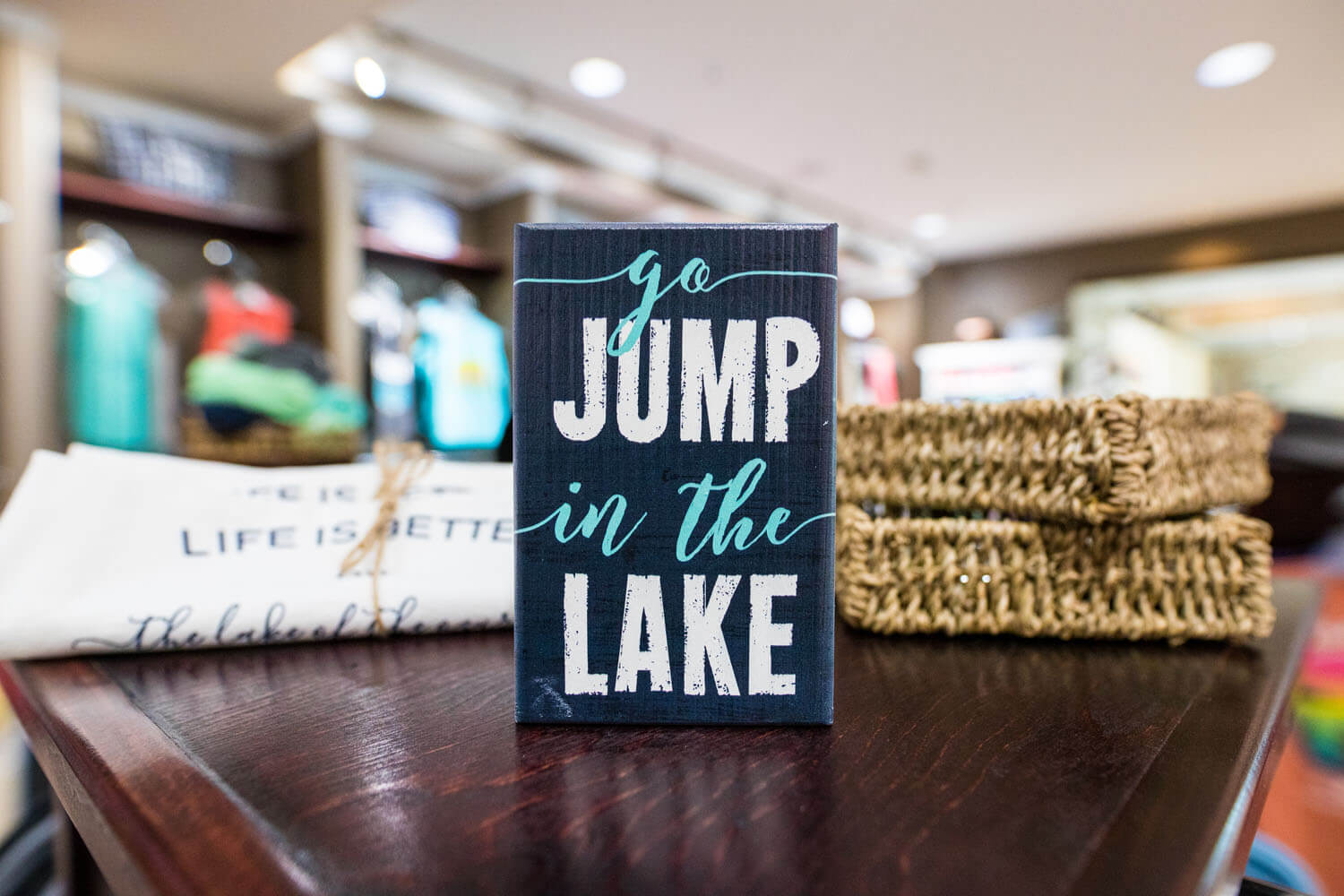 Sign that says go Jump in the Lake