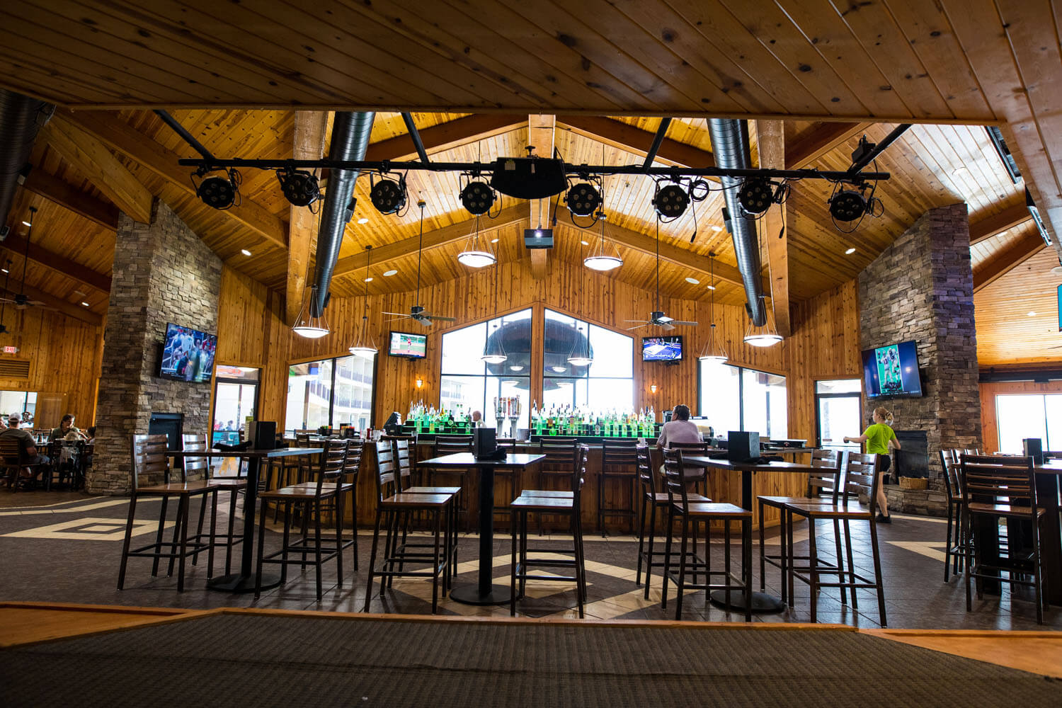 View of the bar and large windows from the stage inside Toad Island Bar & Grill at Camden on the Lake Resort on Lake of the Ozarks