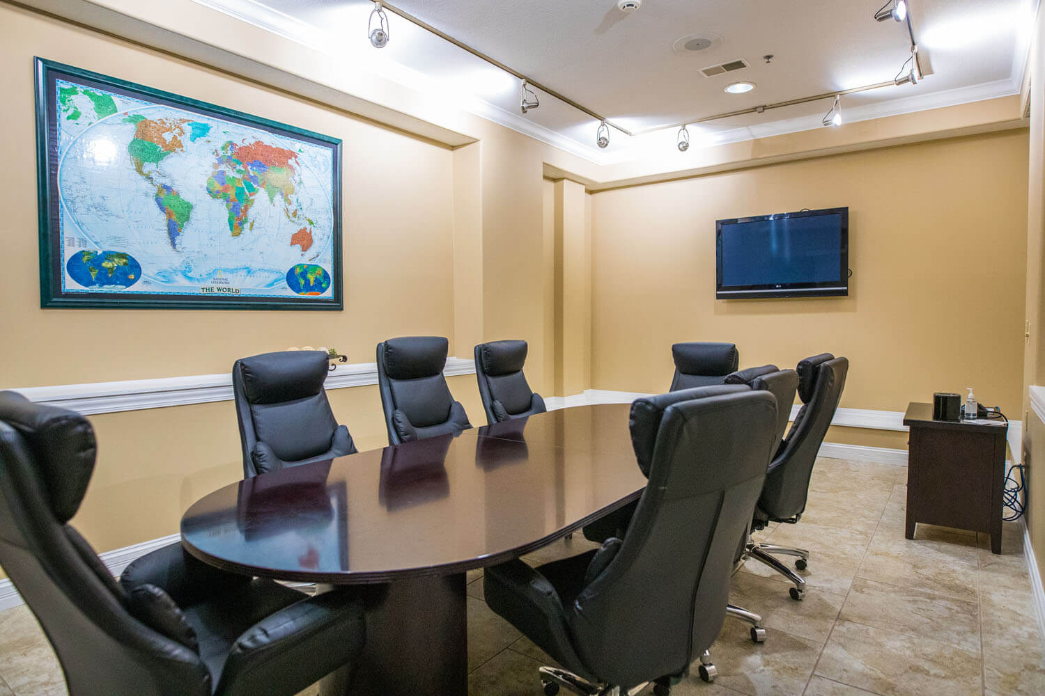Conference room with table, tv and seating for eight at camden on the lake resort - events
