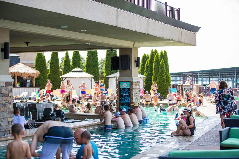 Guests enjoy the pool and swim up bar at Camden on the Lake Resort at Lake of the Ozarks