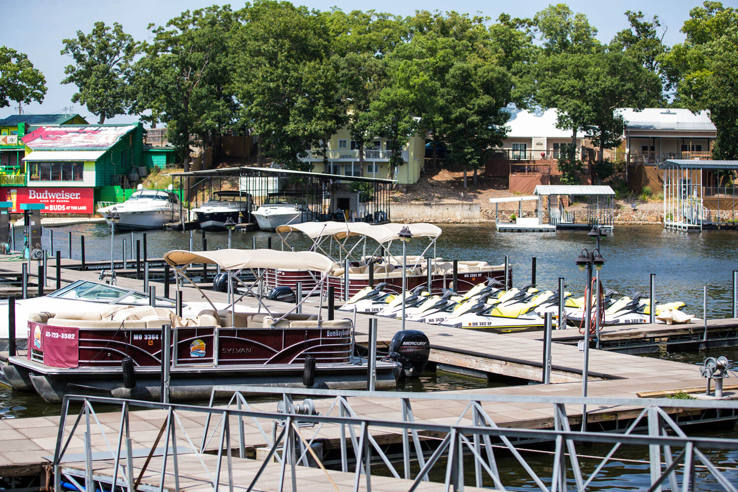 Boats and jet skis are docked in front of Camden on the Lake Resort