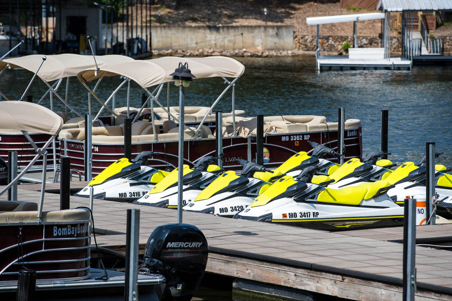 docks in front of Camden on the lake Resort with jet skis and pontoon boats