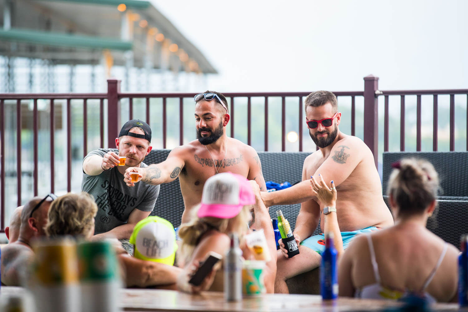 A group raises shot glasses while seated on the patio at Camden on the Lake Lake of the Ozarks