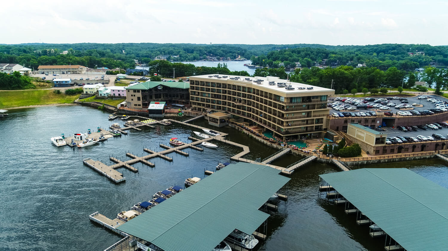 Aerial view showing docks and resort from the lake of the ozarks, camden on the lake resort