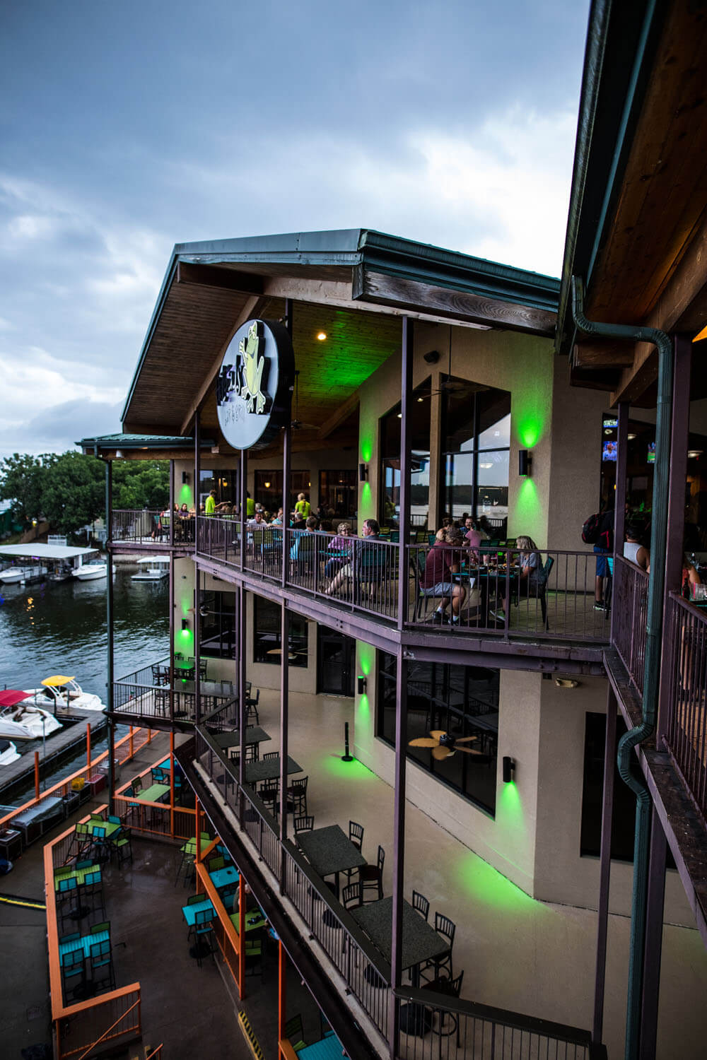 Patio seating facing the lake at H. Toad's Bar and Grill and Camden on the Lake Resort Lake of the Ozarks