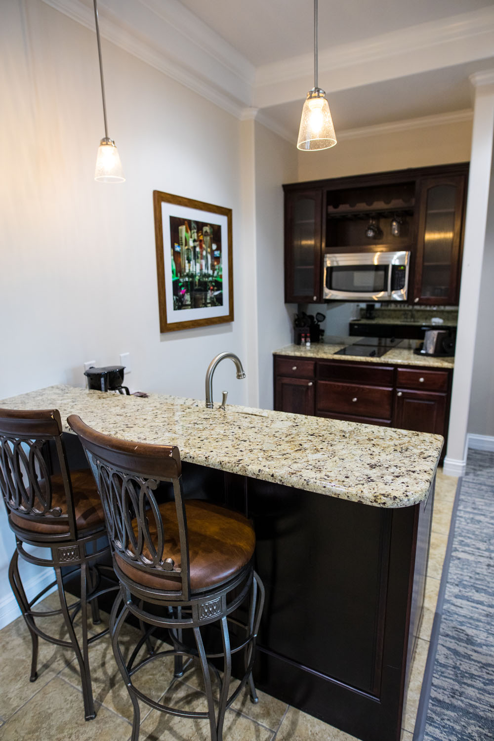 Kitchenette with bar seating for two in room at Camden on the Lake Resort
