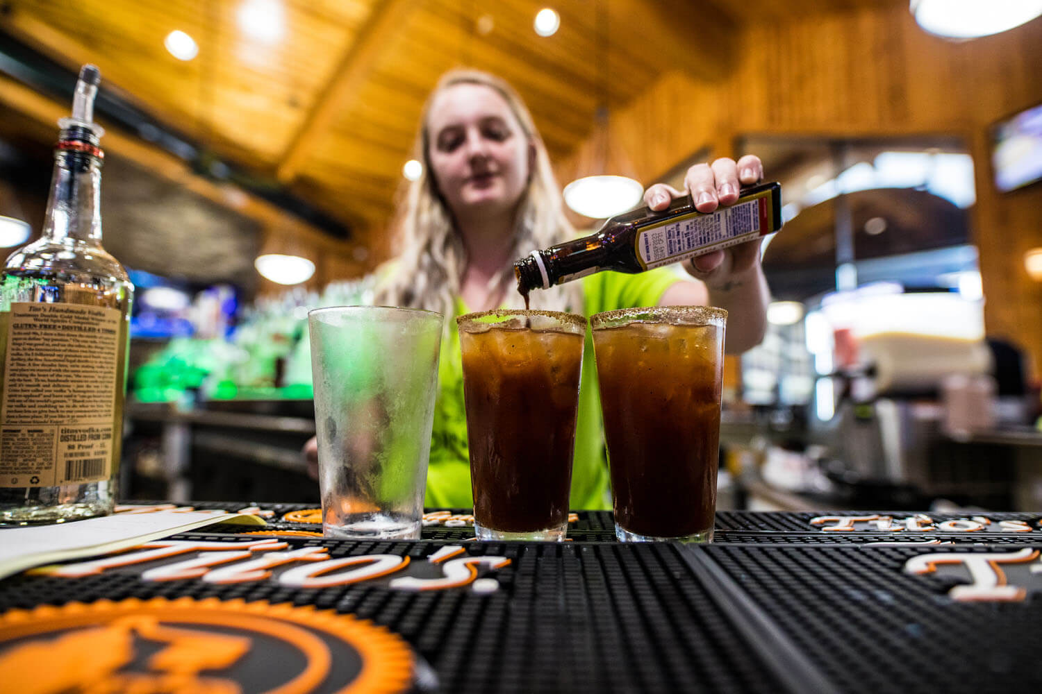 A bartender prepares bloody marys at H Toads Bar and Grill Camden on the Lake