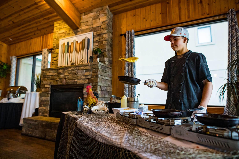 chef preparing an omelette at the omelette bar camden on the lake resort