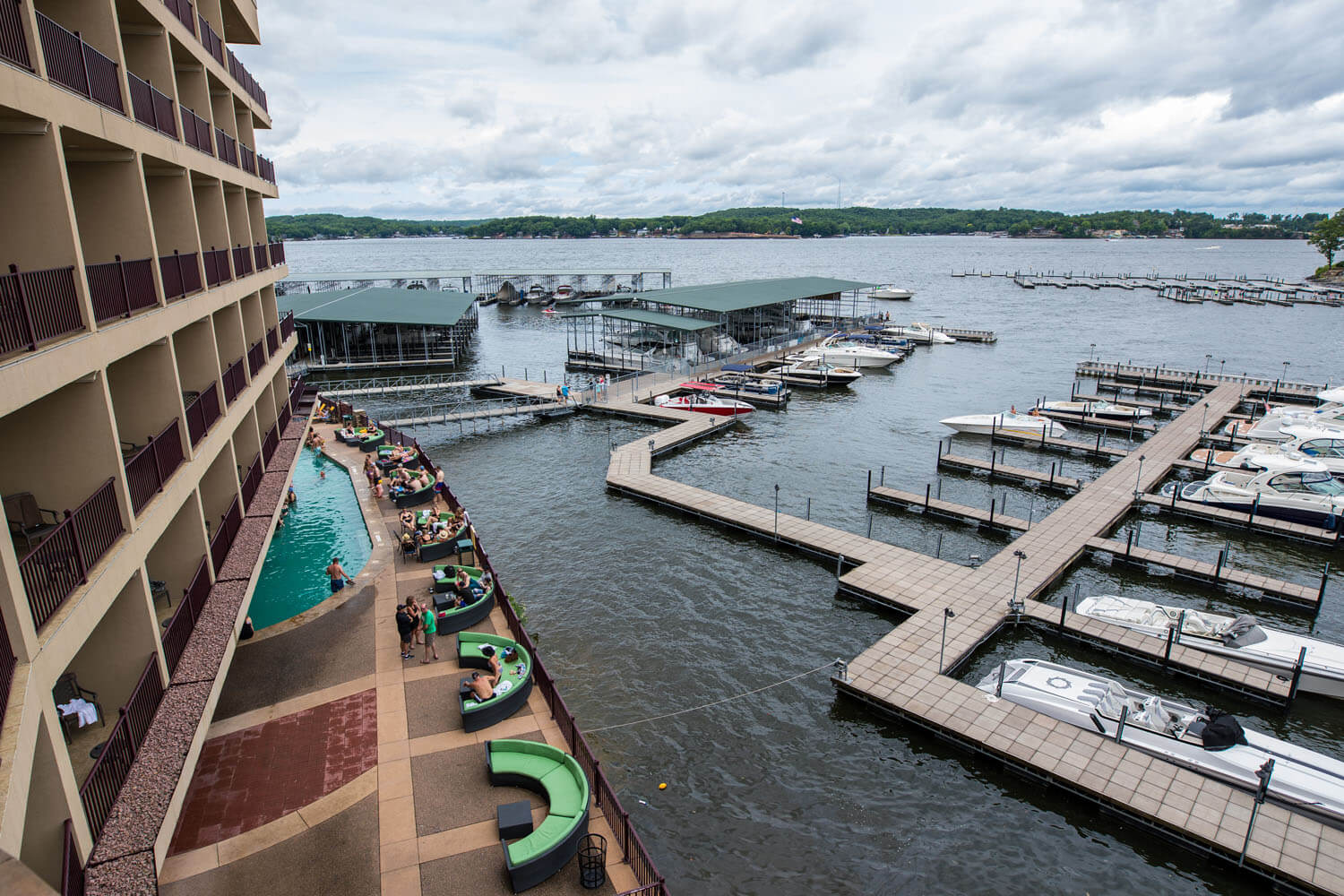 waterfront patio and docks outside of camden on the lake resort on lake of the ozarks
