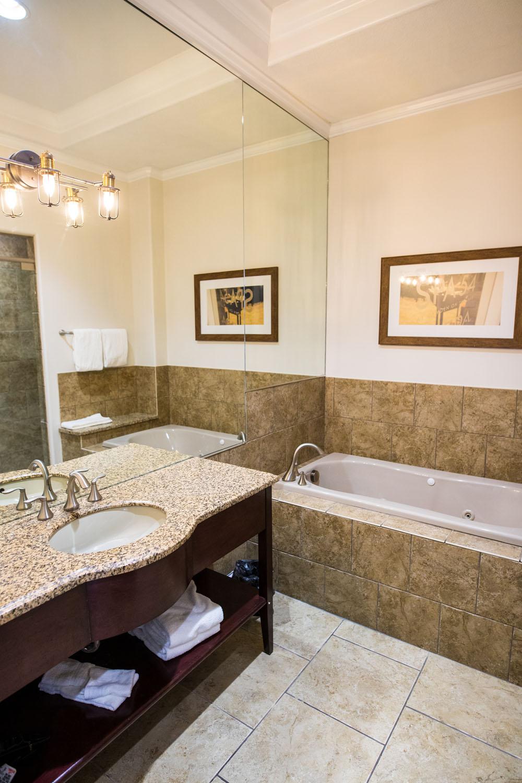 Bathroom with bathtub at camden on the lake - lake of the ozarks resort