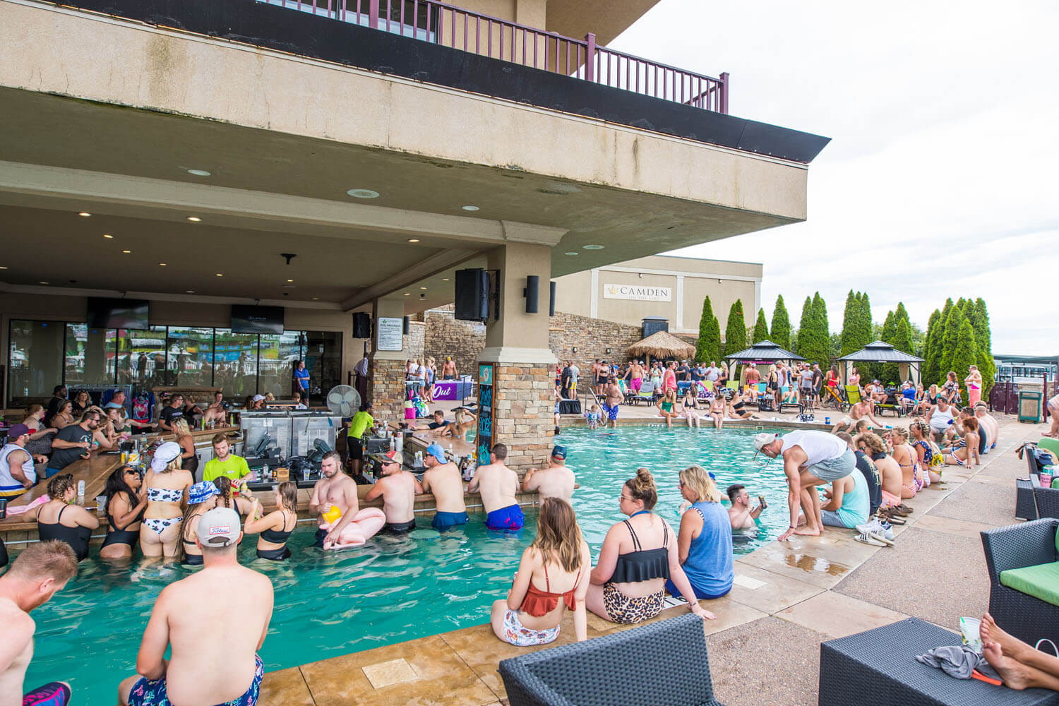 A crowd enjoys the swim up bar and pool at Camden on the Lake Resort on Lake of the Ozarks