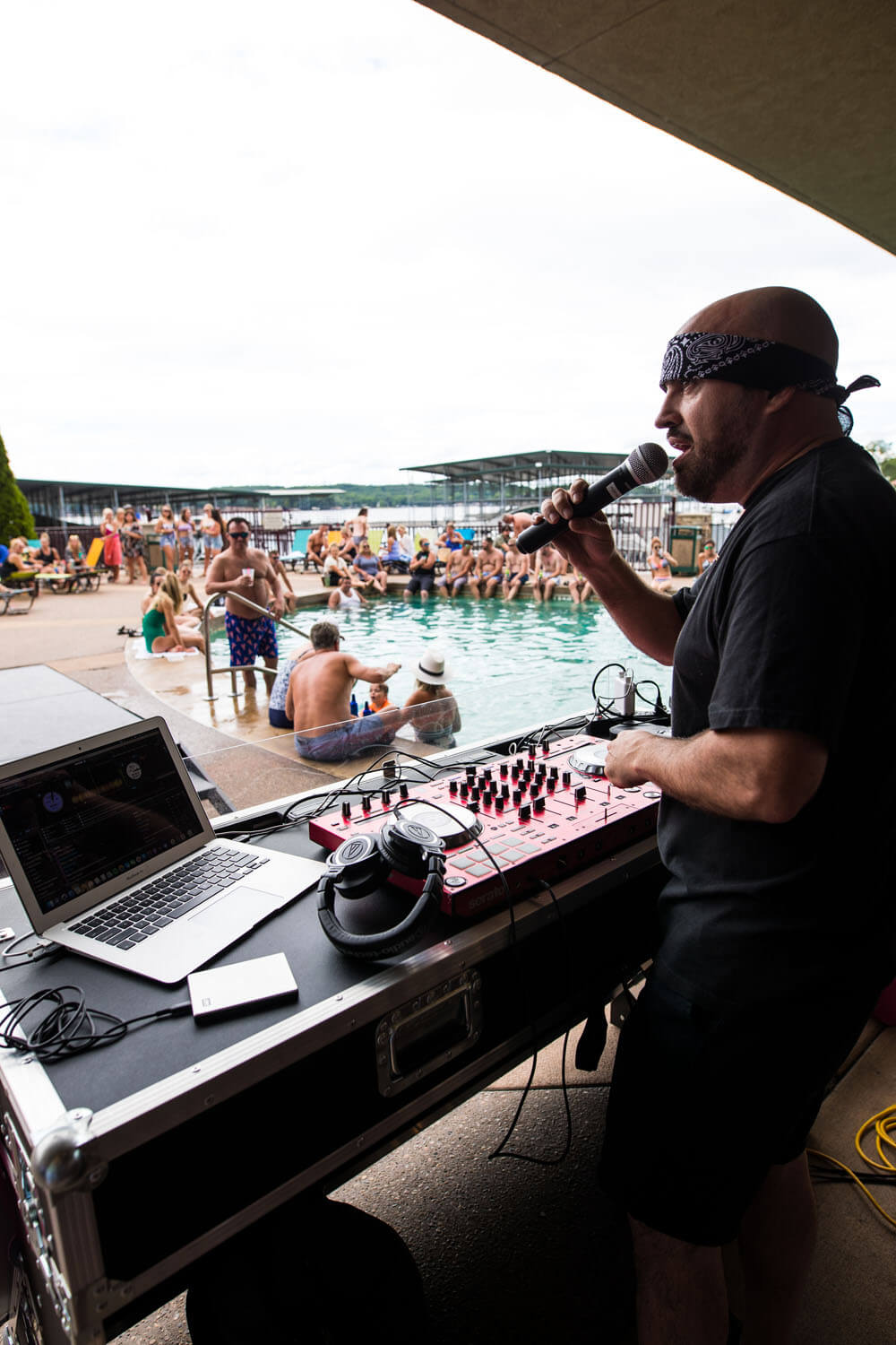 DJ with microphone near pool at Camden on the Lake Horny Toad Entertainment Complex