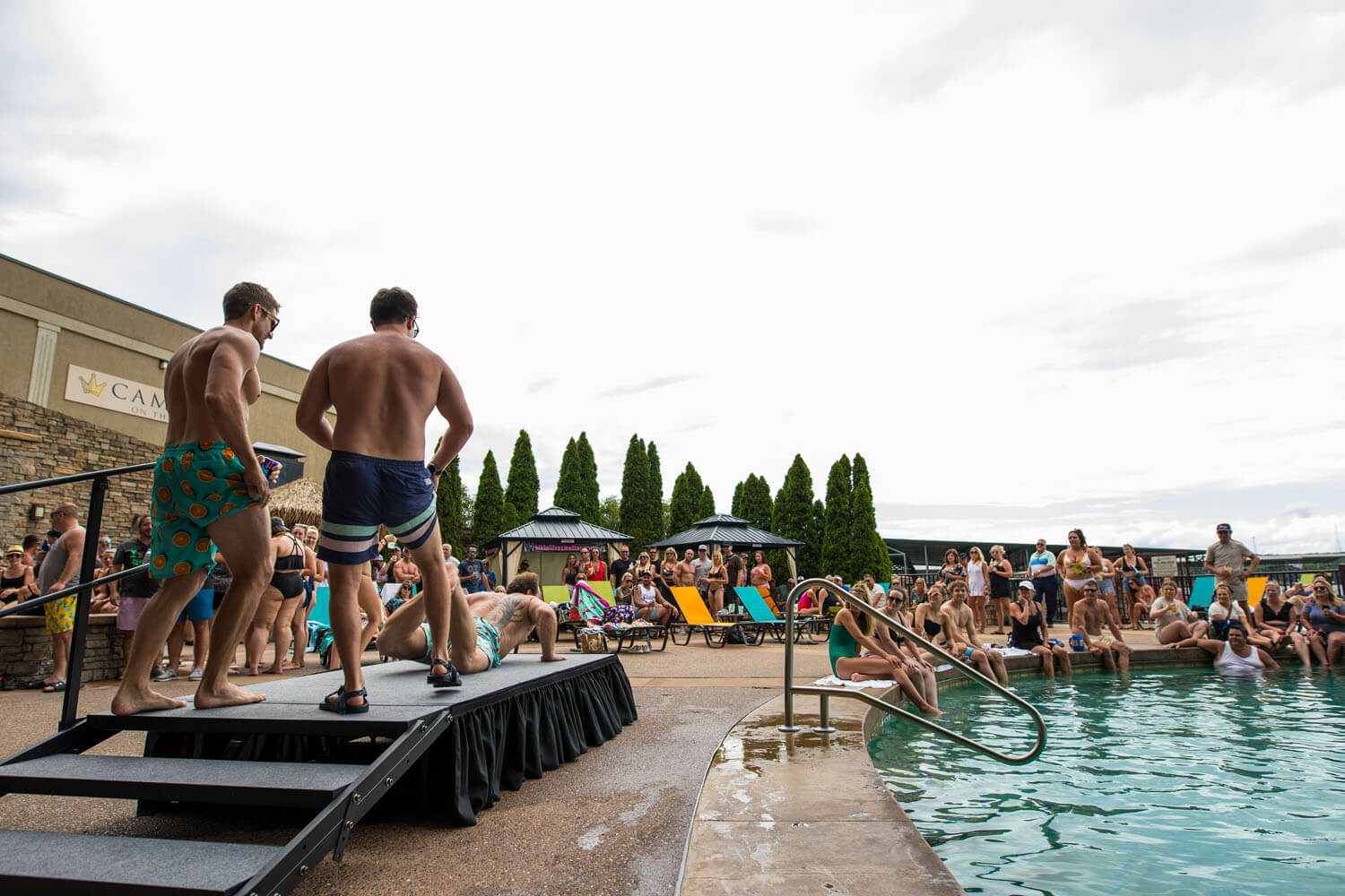 a crowd enjoys the pool at camden on the lake resort on lake of the ozarks