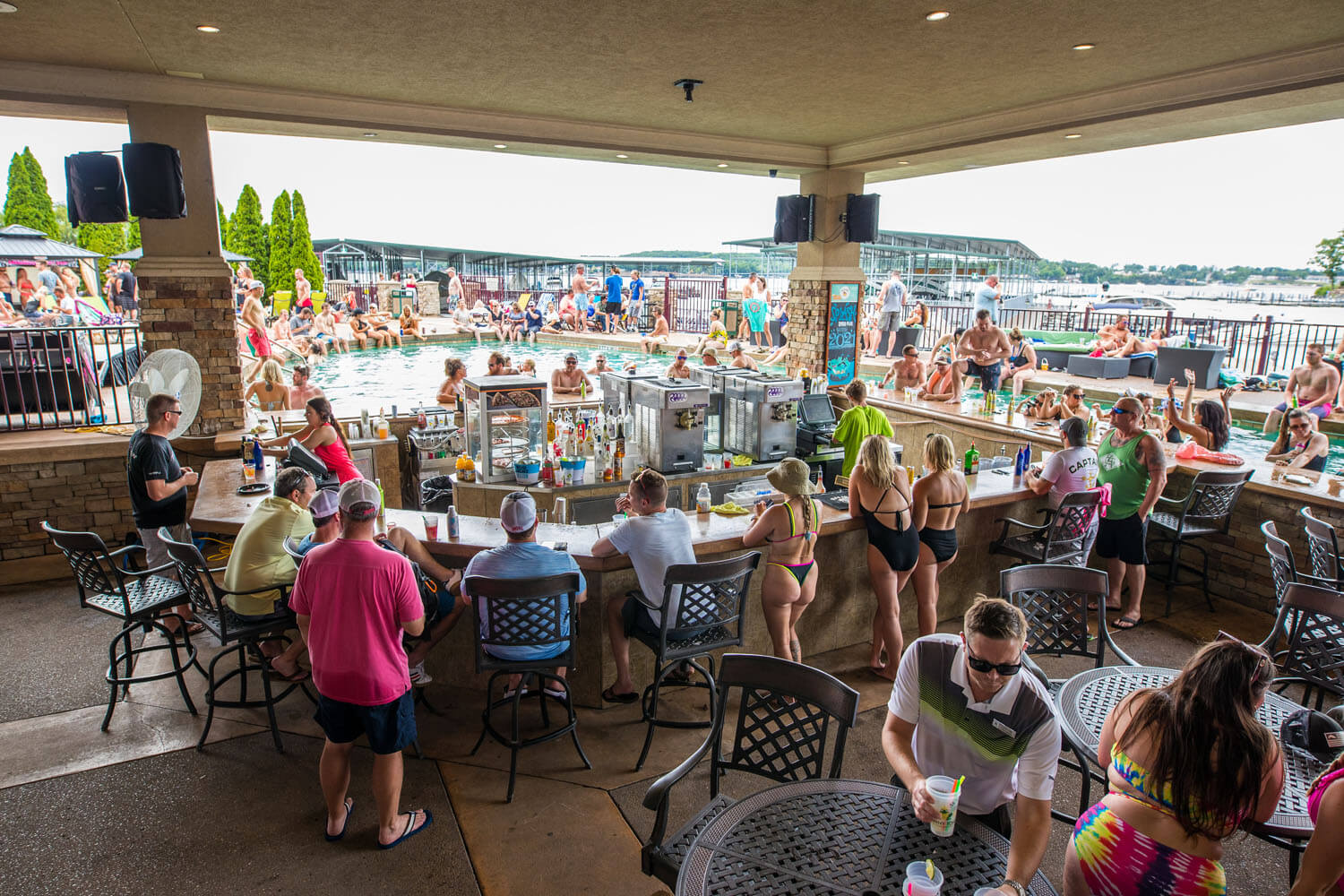 Customers enjoy the outdoor bar and pool at the horny toad entertainment complex at camden on the lake resort