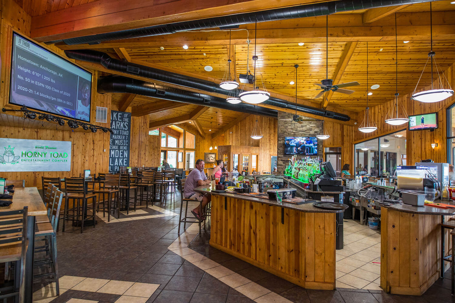Indoor dining and bar seating at H. Toad's Bar & Grill Horny Toad Entertainment Complex at Camden on the Lake Resort