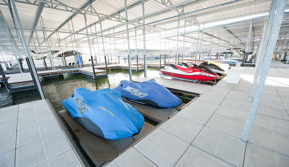 Jet skis docked at Camden on the Lake Resort